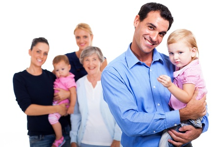 extended family: cheerful father holding his daughter with extended family on background Stock Photo
