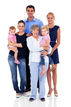 man carrying woman: studio portrait of big family on white background Stock Photo