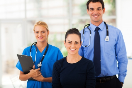 doctor appointment: portrait of woman with health workers in hospital Stock Photo