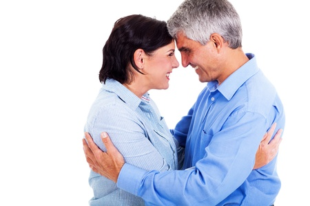 happy middle aged couple hugging each other isolated on white background photo