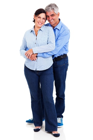 cutout old people: happy middle aged couple embracing isolated on white background