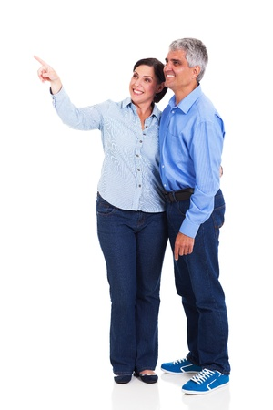 cutout old people: happy middle aged couple pointing isolated on white