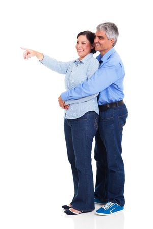 mature woman pointing at copyspace with her husband isolated on white background photo