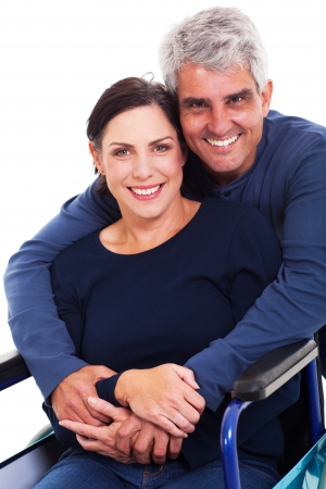 supportive: loving supportive husband hugging disabled wife isolated on white