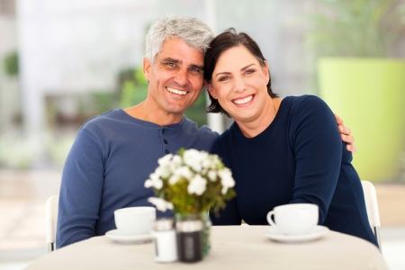 elderly couples: beautiful mature couple having tea at home Stock Photo