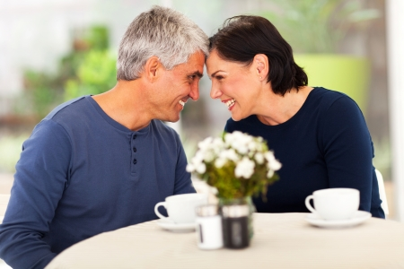 loving mature couple spend time together at home photo