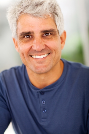 50s man: smiling handsome mature man portrait at home Stock Photo