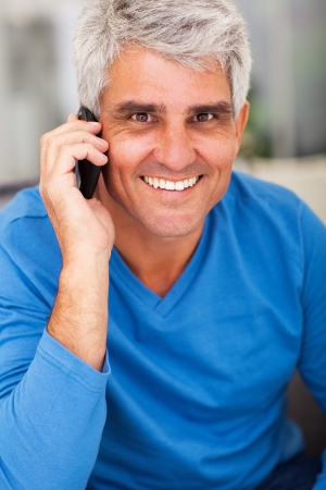 happy mature man talking on mobile phone photo