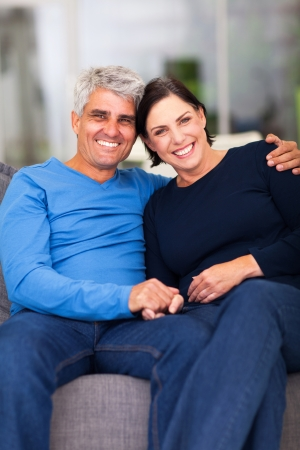 wedding portrait: portrait of loving mature couple relaxing at home