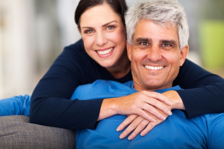 happy loving middle aged couple relaxing at home photo