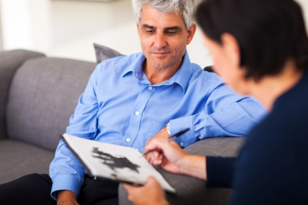 depressed middle aged man in session with therapist photo