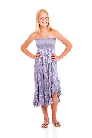 happy pre teen girl in silver dress isolated on white photo