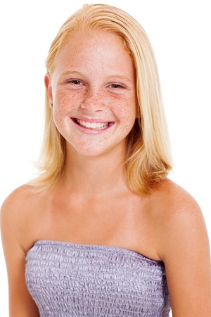 beautiful preteen girl: happy teen girl with freckles isolated on white