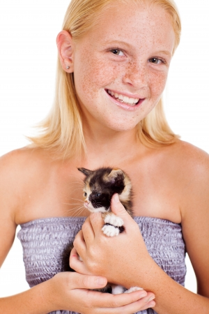 cute freckled teen girl holding a little kitten isolated on white photo