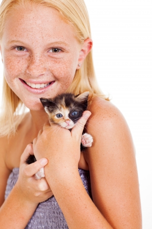 pre adolescents: happy little girl holding kitten isolated on white