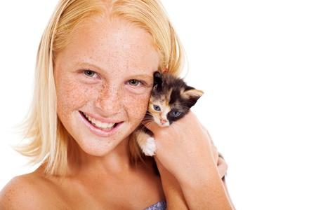 pre adolescence: cute teen girl holding a little pet kitten Stock Photo