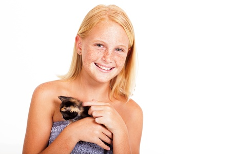 pre adolescence: cute little girl with freckles holding a kitten