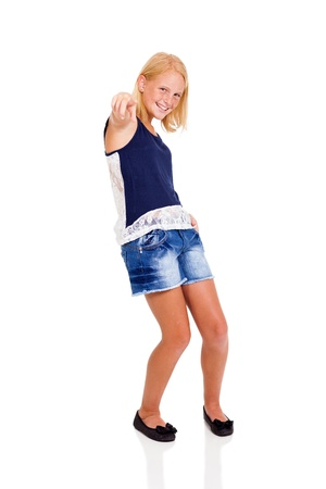 cute teenage girl pointing on white background photo