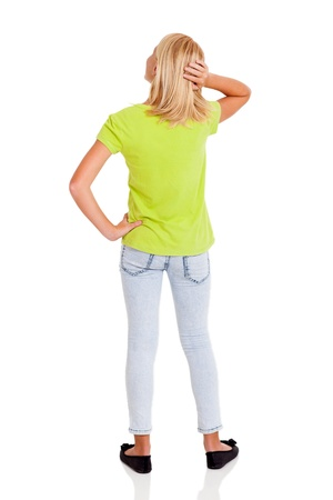 rear view of pre teen girl thinking photo