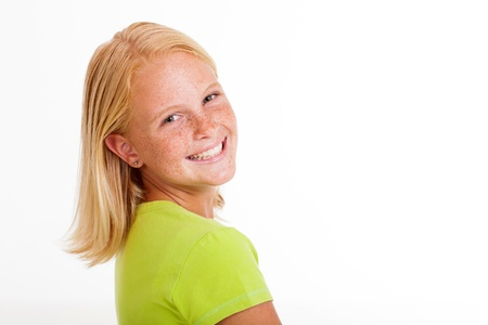 pre adolescents: beautiful preteen girl looking back isolated on white