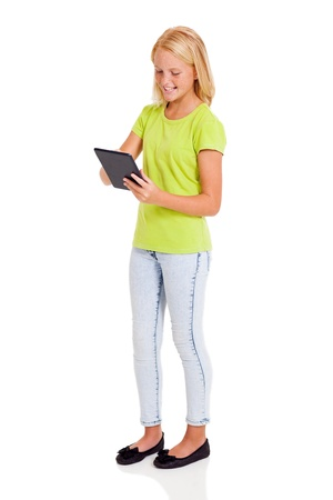 pre adolescent: cute preteen girl using tablet computer isolated on white Stock Photo