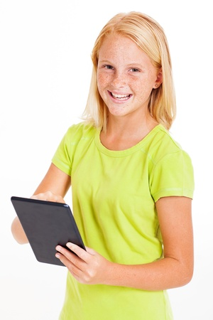 pre adolescents: happy pre teen girl using tablet computer isolated on white Stock Photo