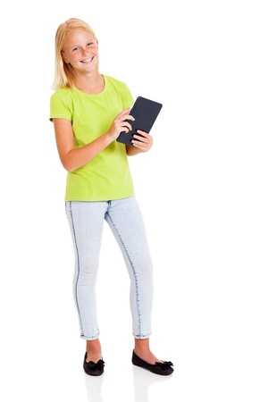 preteen model: beautiful teen girl holding tablet computer isolated on white