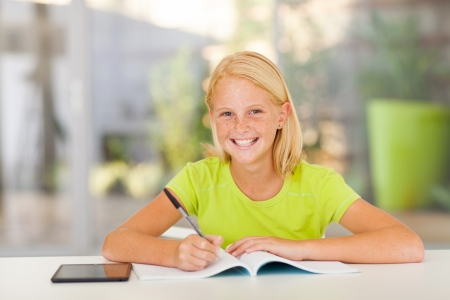 teenage girls: cute teen girl doing homework at home