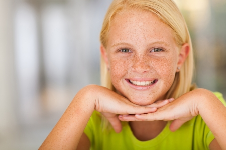 pretty pre teen girl face closeup portrait photo