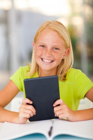 pre adolescents: happy teen girl holding tablet computer at home Stock Photo