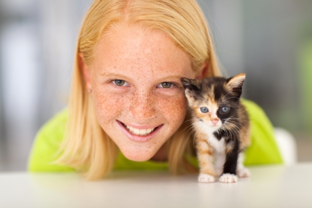 freckled: beautiful teen girl with her little kitten pet Stock Photo