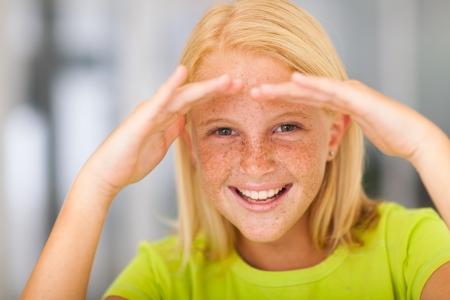 pre adolescent girl: happy pre teen girl looking forward