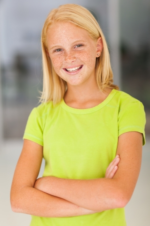 pre teens: confident preteen girl portrait with arms crossed Stock Photo