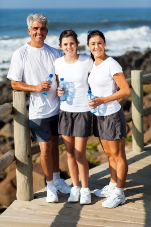 beautiful healthy family at the beach after exercise photo