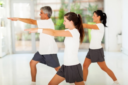 side view of healthy family exercising at home photo