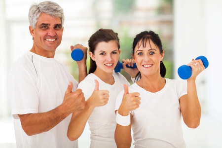 home gym: healthy family giving thumbs up after exercising