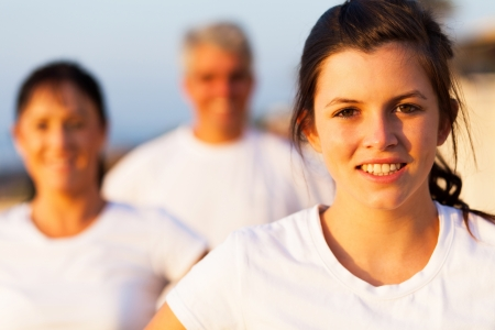 girl woman: beautiful sporty teenage girl outdoors with parents