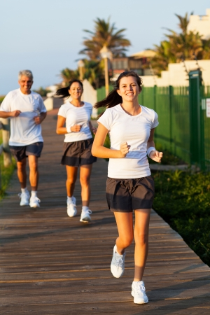 senior woman exercising: fit modern family jogging in the morning