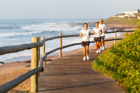 healthy family running by the beach photo