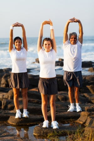 active family exercising at the beach photo