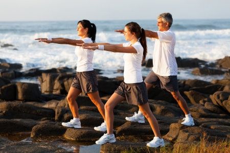 side view of healthy family workout at the beach photo