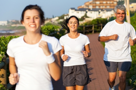 happy active family jogging in the morning photo