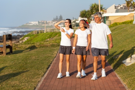 active healthy family walking by the beach in the morning photo