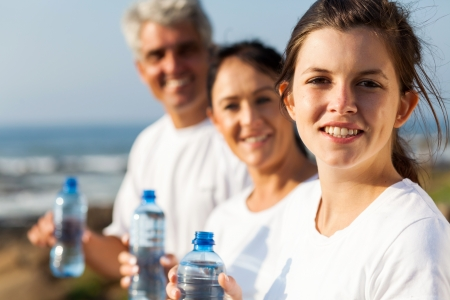 fit family with water bottle after exercise in the morning  photo