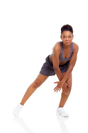 young dancer: portrait of active african woman dancing isolated on white background