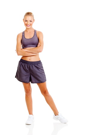beautiful sporty woman with arms folded isolated on white background photo