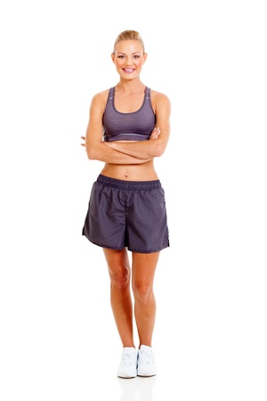 portrait of sporty woman with arms crossed isolated on white photo