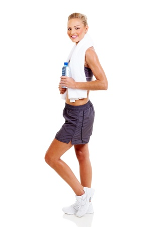 full length portrait of young fit woman after working out, isolated on white photo
