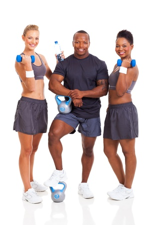 healthy group of young fit people with various gym equipment  photo