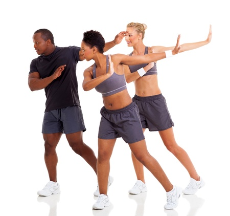 group of young adult doing fitness dance exercise on white background photo